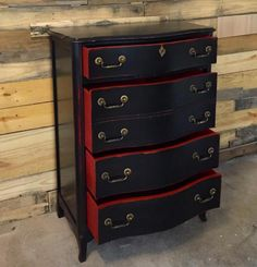 """What a better way to represent your team than to restyle your furniture in their team colors! Reclaimed Karma spoiled one of their customers by painting this dresser in the colors of the Georgia Bulldog football team!  They mention, """"My latest customer loves his Georgia Dawgs! Can u tell? Just finished this little guy inLamp Black with a pop of Brick Red Milk Paint."""""""