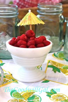 Sweet raspberries for snacking in a small dish from #Goodwill.  .69  cents #milkglass #summer #fruit #pool