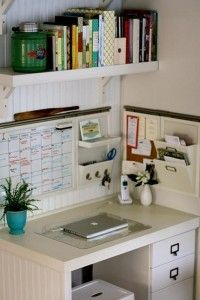 Desk in corner with organizer mounted on adjacent wall