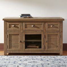 Seneca Media Chest | Constructed from reclaimed pine, this media stand's design retains the rustic warmth of raw wood for casual appeal. Metal knobs and cup pulls in a burnished finish complement the roughhewn look.
