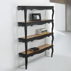 Two coffee tables cut in half, stacked and mounted like a wall shelf.  Clever!
