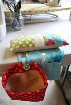 FANTASTIC pincushion! Love this idea: pincushion, wool for needles, scrap bag, pockets for the tools you use the most.