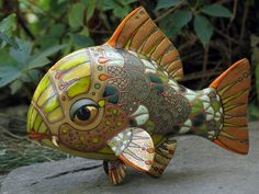Ceramic Creature. Accidentally found on a strange Russian website. Strange creatures of ceramics and imaginative woodcarving designs