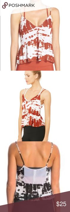 "Alo flutter crop tank red tie dye A fun and flirtatious layer to put a spring in your step to and from practice. The Flutter Tank is crafted from lightweight modal with a micro-mesh panel on the back. Cropped peplum hem reveals a bit of midriff. On-trend cropped silhouette Feminine flutter drape Ideal for to/from practice 23"" length from shoulder to hem.  View Size Chart  Fabrication: Modal Jersey + Micro Mesh Mesh detail at center back ALO Yoga Tops Crop Tops"