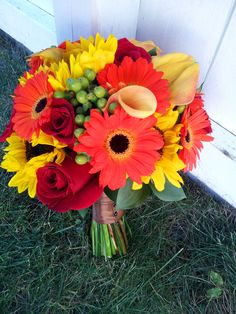 Dahlia Floral Design sunflowers roses and gerbera daisy bridal bouquet in red, orange, yellow