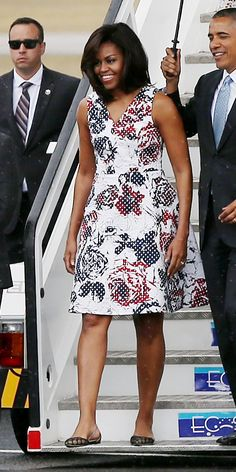 Michelle Obama's Best Looks Ever - 2016 - White Printed Dress. The First Lady touched down in Cuba in a white V-neck dress with a graphic red and black print.  - from InStyle.com