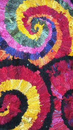 Three spiral rag rugs.  Played around with several rugs the last time I had my camera out.  This was fun.  The rug at the top is Colors of India; lower left is Red and Gold Spiral, and lower right is Red Nautilus.
