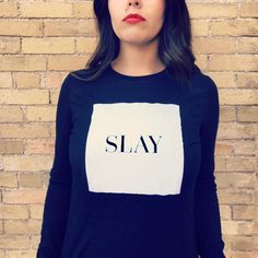 SLAY. Beyonce said it best, girlfriend.  Long sleeve shirt available in black…