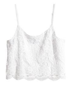 Short camisole top in lace with narrow, adjustable shoulder straps. Jersey lining.