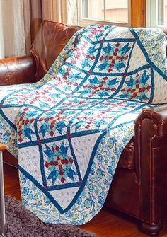 Abbigail, by Krisanne Watkins, is a pretty floral quilt that takes advantage of several easy techniques for block assembly. This throw quilt uses red squares to make a chain through the on-point blocks, giving this quilt extra pizzazz!