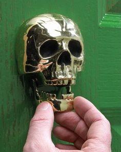unusual door knockers may reveal what sort of person resides within Polished Brass Skull Door KnockerPolished Brass Skull Door Knocker Door Knockers Unique, Door Knobs And Knockers, Brass Door Knocker, Memento Mori, Celtic, Unique Doors, Door Furniture, Skull And Bones, Skull Art