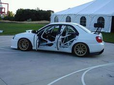 Caged Subaru STi.... hmmm this looks familiar :) -- mine definitely won't have a backseat<3 rally4life