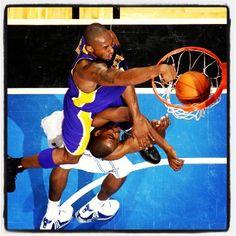Kobe slammin on Dwight's face!