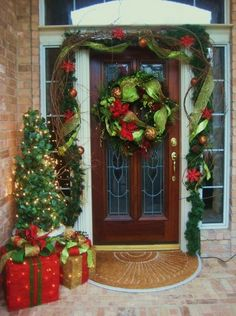 Christmas Porch. Like the bright with the vines.  Whimsical and cottage looking.