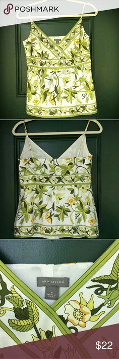 Ann Taylor Floral Tank This floral spaghetti strap tank is as close to new as it gets. No holes, no stains, no rips. There is a side zipper. 100% cotton shell and acetate liner  No pets, no smoking, no trades. Ann Taylor Tops Tank Tops