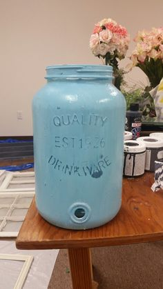 Glass jar purchased for $5. Diy chalk paint plaster of paris method colored with a little americana decor chalky paint to make it blue. Sealed with clear wax.