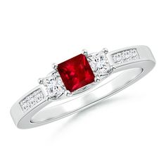 Propose her with our romantic and symbolic ruby and diamond three-stone ring.