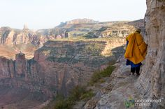 Following the 78-year old monk on a cliff's edge to the 6th century cave church of Daniel Korkor in Tigray, Ethiopia. Yes, it is as steep a cliff as it looks...