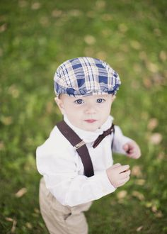 this little guy is just too cute in his plaid cap and bow tie   Photography By / alixannlooslephotography.com