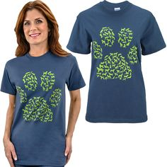 Dog Paw Breeds T-Shirt   You love dogs. All dogs. Our soft cotton tee shares your affection with a multitude of dog breeds depicted in silhouette within a paw print pattern. * 100% cotton * Machine wash warm, tumble dry medium, do not dry clean *  Shirt imported, country of origin may vary by size and color