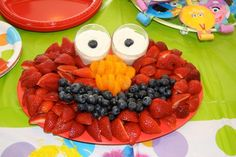 Fresh fruit arranged to resemble the face of Elmo.  See more Elmo birthday party ideas at www.one-stop-party-ideas.com