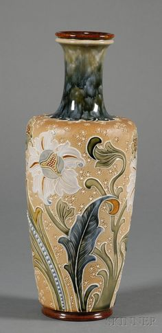 Doulton Lambeth Stoneware Vase, England, late 19th century, enameled and raised floral decoration to a textured ground, artist signed Florence Roberts.