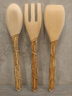 Wood burned utensil set *designed and wood burned by hand *12.5 inches long *purchase individually or the set of 3 *available: spoon, fork, flat ended spoon *food safe & ready to use *hand wash and treat with mineral oil