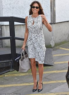 A spring in her step: The TV personality seemed to be dressed for summer in her pretty mon...