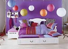 This mixes some of the deep red/burgundy with purple and warm oranges.    bedroom ideas for women - Bing Images