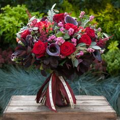 Love Affair - An amazing hand tied arrangement designed straight out of our fabulous Chelsea studios. It is one of our most popular winter warmers and an absolute gem of an arrangement. The luxury bouquet includes large calla lilies and amazing 'red Naomi' roses as well as other flower fillers and foliages that include astilbe, cotinus, hypericum berries, snowberry and eucalyptus.