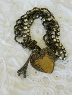 vintage repurposed assemblage jewelry handmade charm bracelet with eiffel tower and heart by atelier paris on etsy
