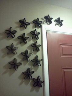 Really fun and easy to do. Just save up old rolls of toilet paper or paper towel holders, then paint and cut. Hot glue togeter when done. You can do them on the wall like the picture or hang them from the ceiling with string.