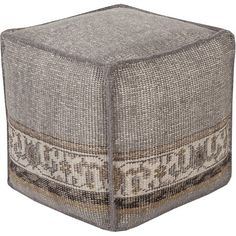 Kick up your feet in the den or offer an extra seat around the coffee table with this artfully handcrafted wool pouf, showcasing an elegant floral design.