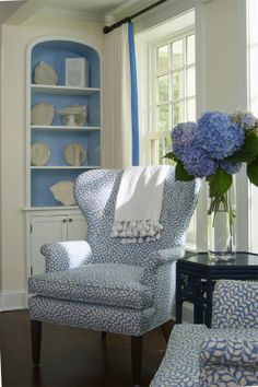 Love these blue and white chairs. Very pretty blue trim on the drapery and the inside of the shelves.