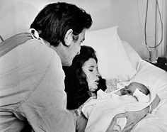 Johnny & June with newborn son John Carter Cash, March 1970. Credit says to J.T. Phillips—Sony Music Archive