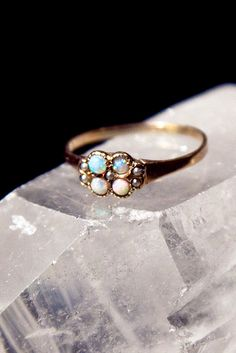 vintage ring.  fashioned in late 1800s-early 1900s  4 small opals and 5 tiny seed pearls