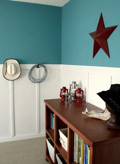 Boy's Room Idea: cowboy/western theme.  Like the architectural detail on the walls & the coat hooks used for a lasso & cowboy hat