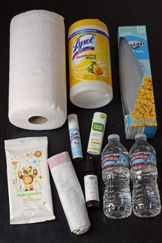 You never know when your child might feel queasy on the road, so pack a box of supplies for cleaning up so you're prepared for car sickness.