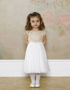 Pretty sparkle party dress, lace bodice with delicate capped sleeves, sequin detailing along neckline, satin shine lining and tie back belt .