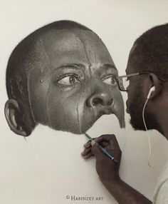 Self-taught artist Arinze Stanley's hyperrealistic pencil portraits.
