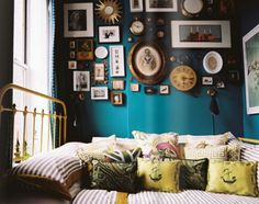 Iron bedframe is going to be my next purchase.  Working on the frame wall with peacock blue accents.  I want it alllll.