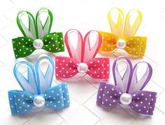 Polka Dot Bunny Ears Hair Bow  ● Size: Approximately 2.25 inches wide and 2.25 inches tall ● Material: Grosgrain ribbon, heat sealed to