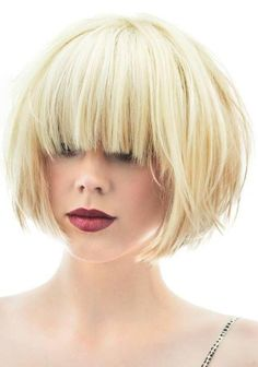 short blonde blunt bob with fringe. thick and straight