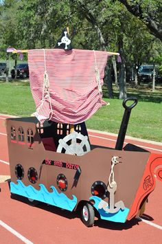 cardboard pirate ship. Can you imagine going trick or treating in this?!? So cute.