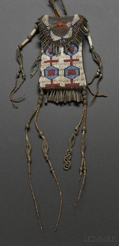 CHEYENNE BEADED COMMERCIAL LEATHER STRIKE-A-LIGHT BAG, C. 1870S, BEADED ON THE FRONT AND PARTIALLY BEADED FLAP AND BACK, WITH CLASSI... - Skinner Inc