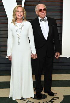 Jane and Jimmy Buffet walking into the Vanity Fair Oscars Party wearing Sidney Garber's Pearl & Rose Cut Diamond Necklace & Dangling Teardrop Earrings #oscars