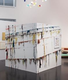 "Elana Herzog, ""Romancing the Rock"", 2010. Textiles and metal staples in two sides of a drywall cube."