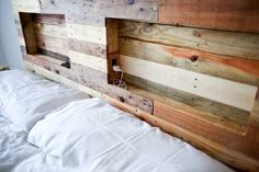 Pallet headboard with integrated lights and plug-ins