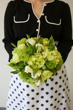 Green is the way to go! A striking bouquet against a white dress!