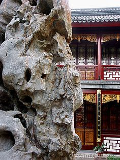 Rock and classic building in Chinese garden